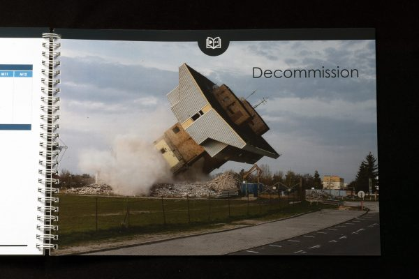 BOOM... toppling a tower that's being decommissioned and no longer needed